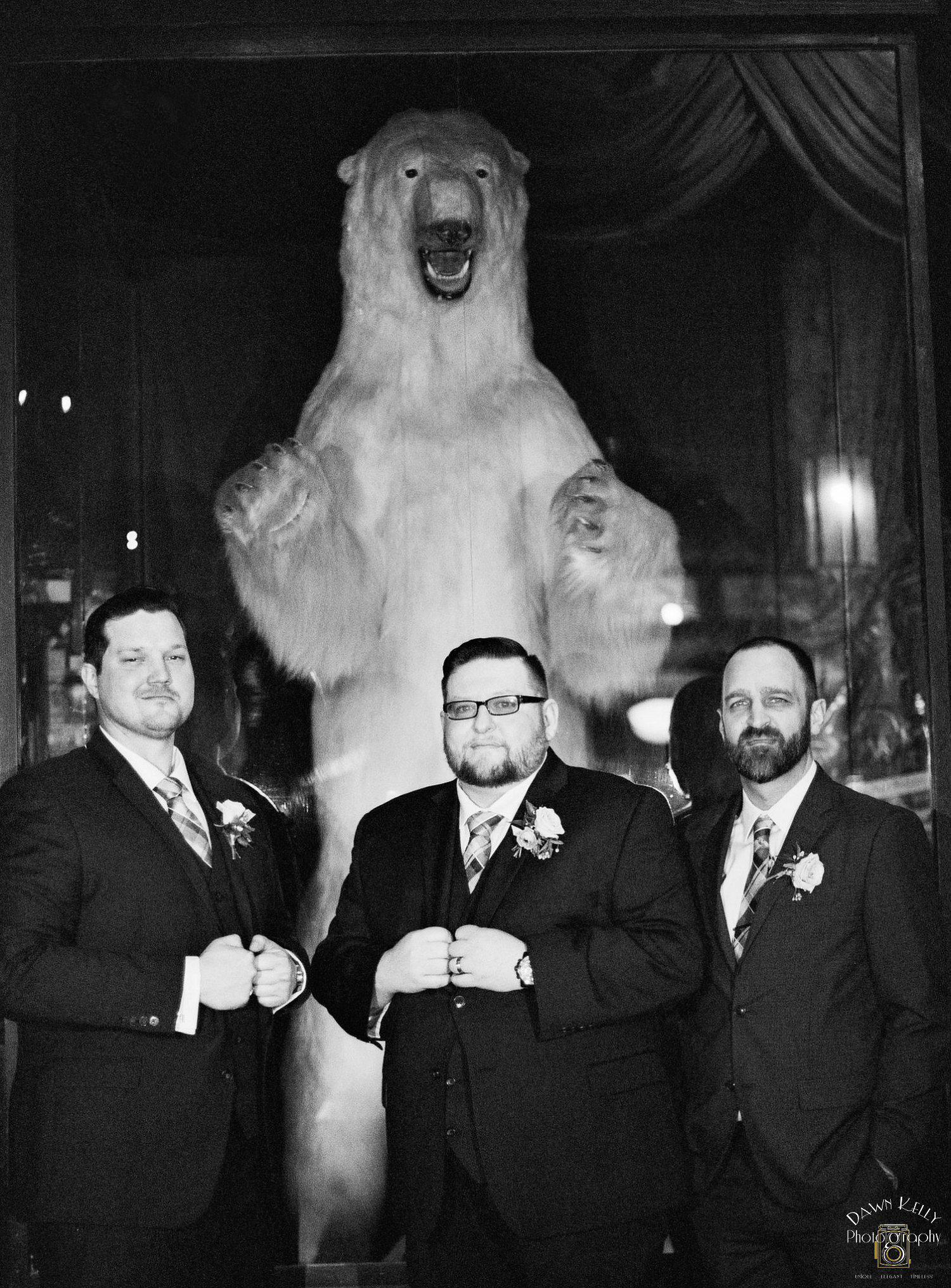 Groomsmen with a polar bear