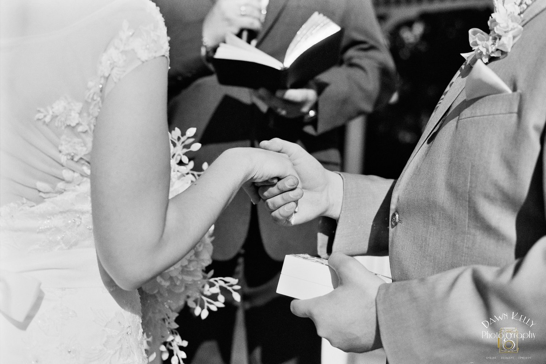 Bride groom holding hands ceremony