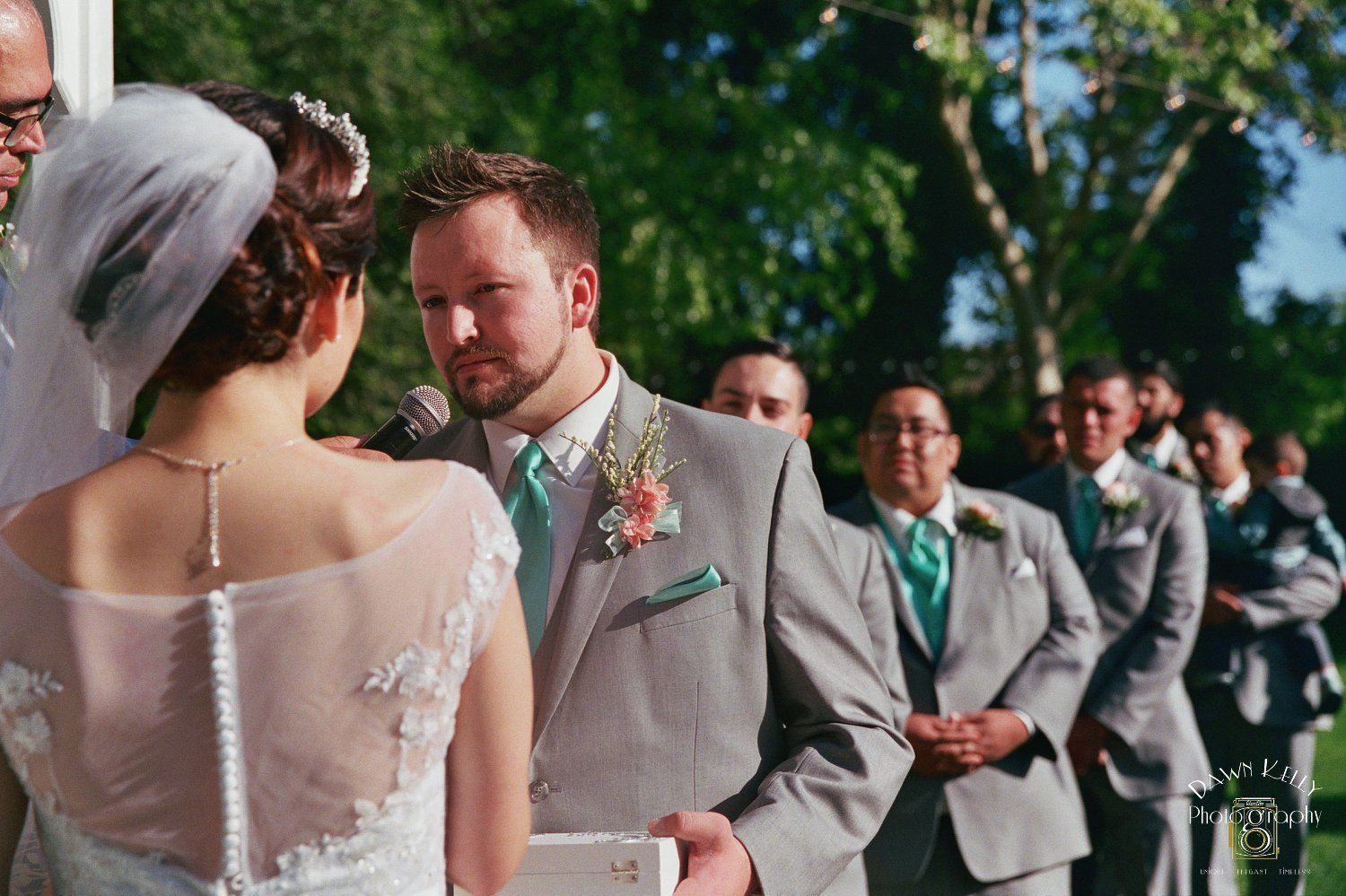 Groom saying vows at Vintage Gardens ceremony