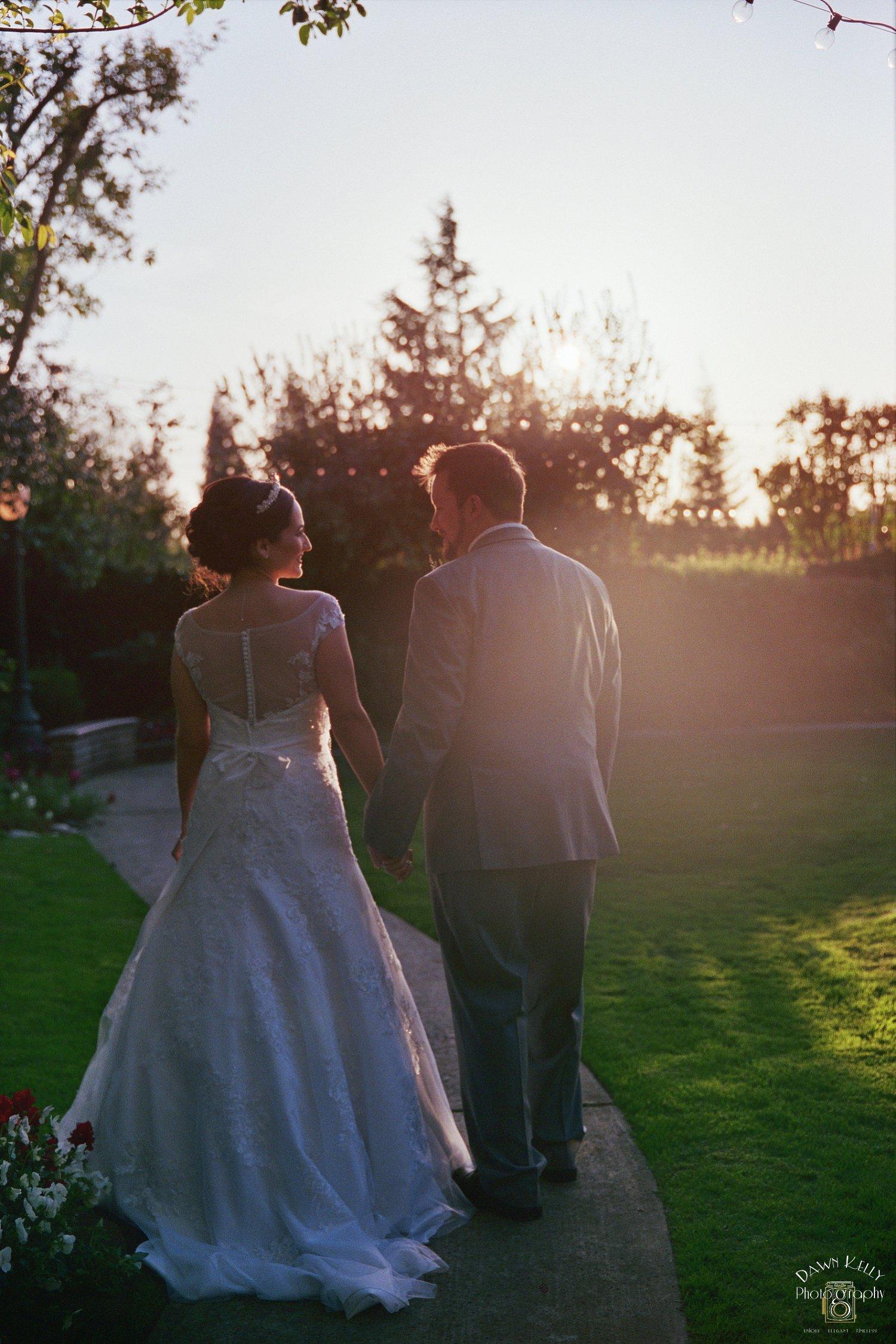 Bride and groom walking Vintage Gardens