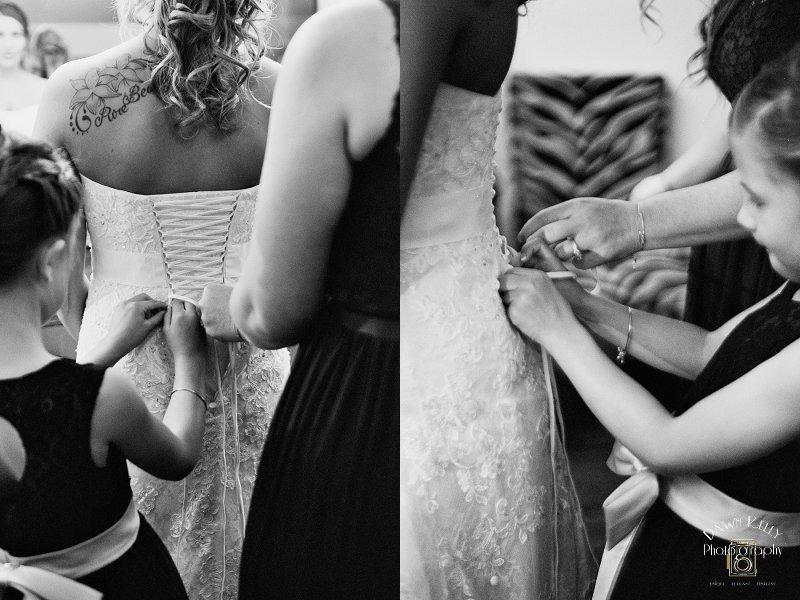Bride's daughter lacing up wedding dress