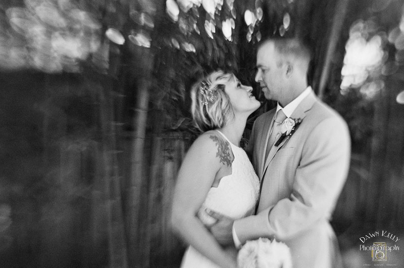 Black and white tilt-shift photo of bride and groom
