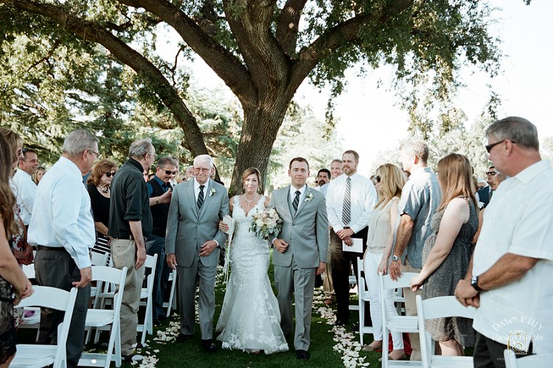 Bride walking down the aisle at Spring Creek Golf & Country Club